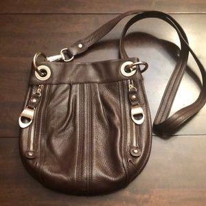 Gorgeous B Makowski purse with silver accents.